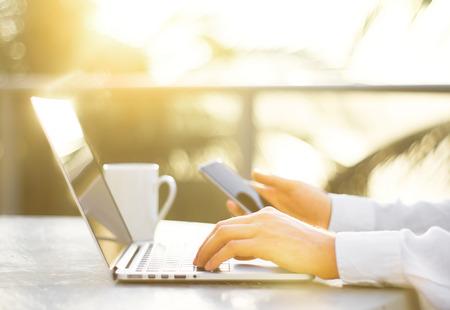 desks: businessman hands typing on a cellphone, close up Stock Photo