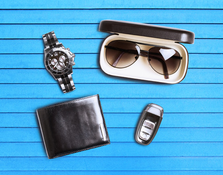 modes: set of mens accessories on a blue wooden background