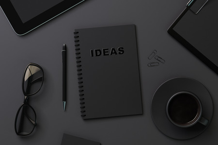 clean office: black notebook for recording ideas, close up