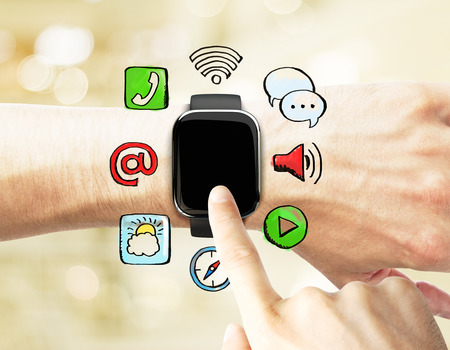 male arm: man uses a smart watch, with social media icons Stock Photo