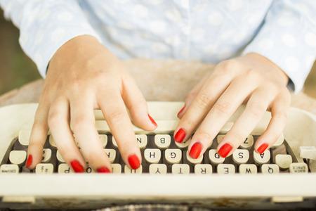 bureaucrat: woman typing on a typewriter