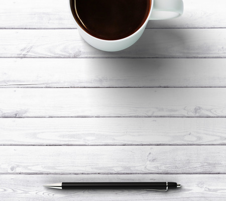 cup of coffee with pen and place for you text