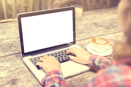 woman: girl with a cup of coffee and a blank laptop, mock up