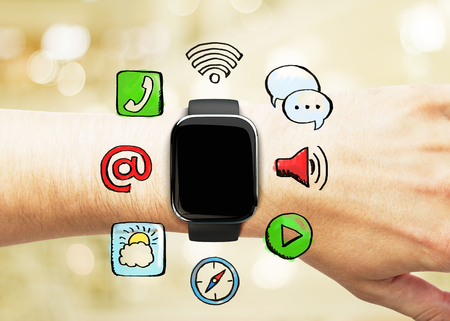 mans watch: Smart watch on a mans hand with social media icons, concept