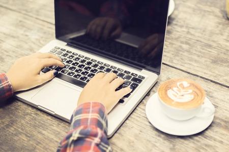 cappucino: Girls hands, cappucino and laptop outdoor