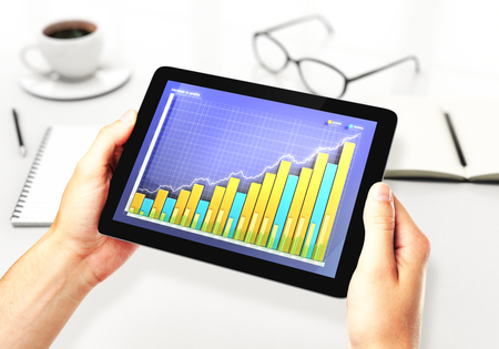 illustration of Financial graph on a digital tablet in office