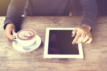 blank tablet: Girl hands, digital tablet and coffee, vintage photo effect Stock Photo