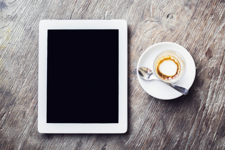 blank tablet: Blank digital tablet and cup of coffee on a wooden table