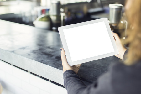 girl with blank digital tablet in cafe, mock up Stock Photo - 45884612
