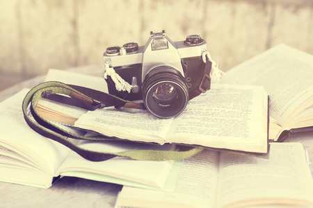 page views: Old photo camera and books, vintage photo effect