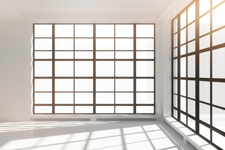 床から天井までの窓と空の白いロフトのインテリア