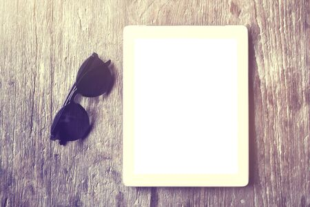 blank tablet: Blank tablet with sunglasses on a wooden table
