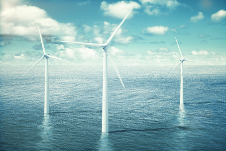Wind turbine farm in the ocean Stock Photo