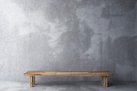 suelos: Banco de madera en una habitación con piso de concreto y muro de hormigón Foto de archivo