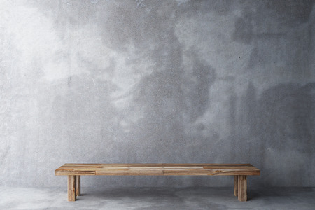 spotlight white background: Wooden bench in a room with concrete floor and concrete wall Stock Photo