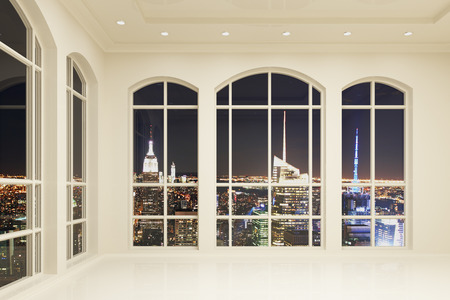 White loft interior with big windows and city view at night