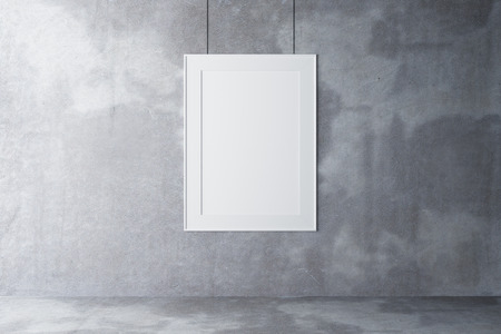 Blank picture frame on a concrete wall and concrete floor, mock up Фото со стока