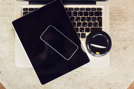 blank tablet: Blank cell phone, digital tablet, laptop and coffee Stock Photo