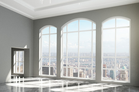 office window view: MOdern room with windows in floor and city view