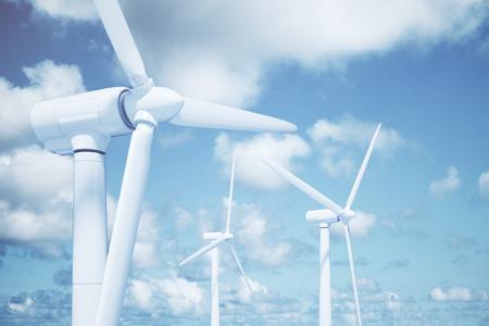 energia electrica: Molinos de viento con el fondo del cielo y las nubes
