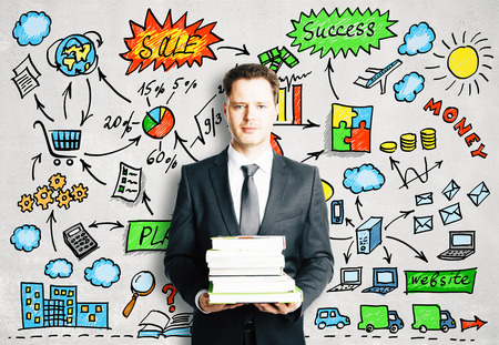 business marketing: Businessman with books and strategy concept scheme Stock Photo