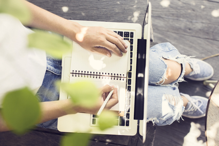 business letter: Girl with laptop, diary and a pen Stock Photo