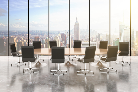 concrete room: Conference room with round table, chairs, concrete floor, windows in floor and city view