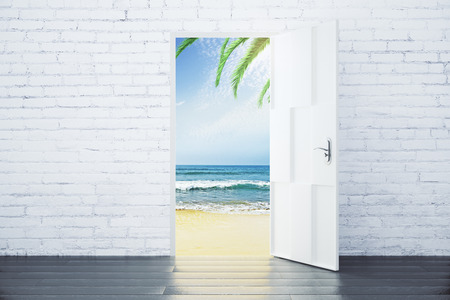 Open door in a beach with ocean waves and palm trees, concept Stock Photo