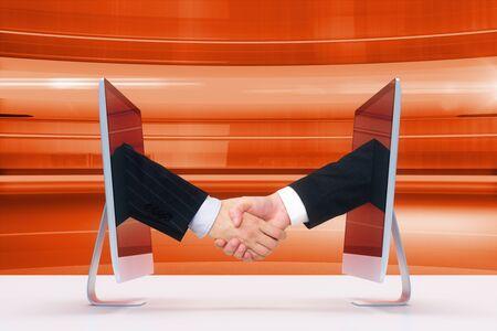 people shaking hands: Handshake of two monitors via the Internet
