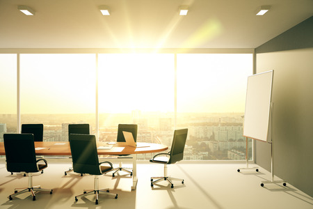 Boardroom meeting: Modern conference room with furniture and city view at sunrise