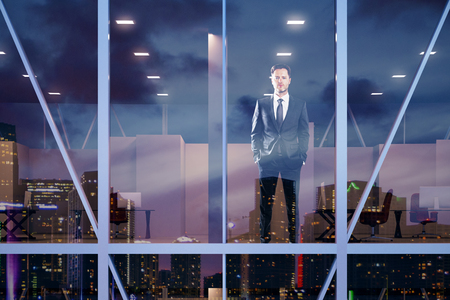 window reflection: Businessman staying in modern office in vitreous business center