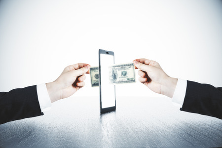 Money transfer with man hands and digital tablet concept Standard-Bild