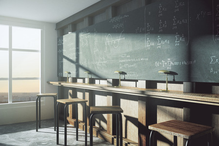 wood window: Vintage college classroom with equation solution on blackboard at sunrise