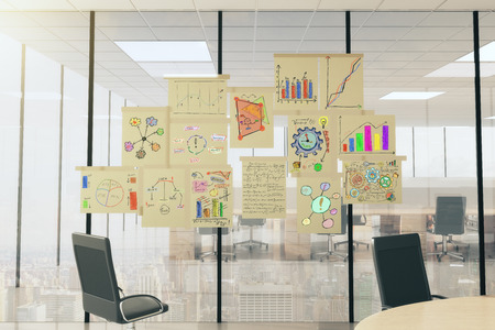 vitreous: Business scheme concept posters on vitreous wall in light office