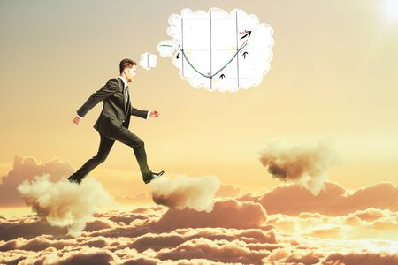 sky clouds: Man thinking about business graph and walking on clouds concept