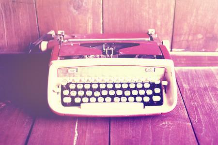 publicist: Old style typewriter on wooden floor Stock Photo