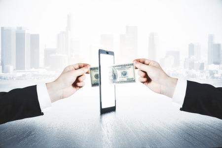 A man passes another man money through smartphone, online money transfer concept