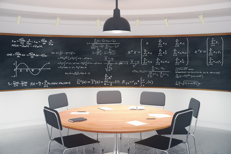 computer classroom: Modern classroom with blackboard with equations and furniture Stock Photo