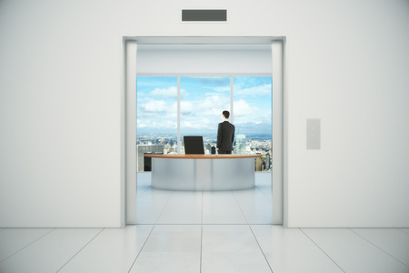 open windows: Businessman in his office vith city view from the elevator doors