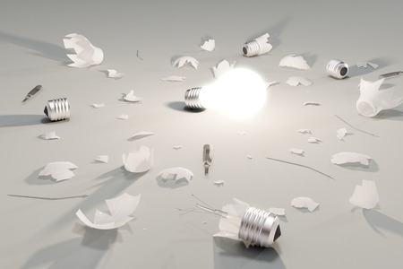 lightbulb: Idea or decision concept with glowing lightbulb and broken lightbulbs Stock Photo