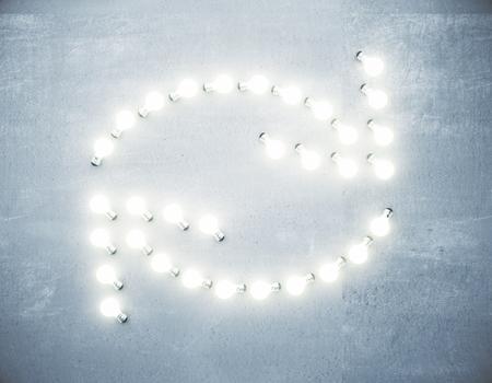 Refresh arrows of glowing lightbulbs on concrete wall