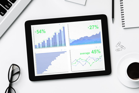 pc screen: Business charts on digital tablet screen with glasses and cup of coffee Stock Photo