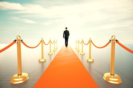 businessman walking: Businessman walking on red carpet to the sunny future concept
