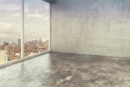 Empty loft interior room with concrete walls, floor and city view