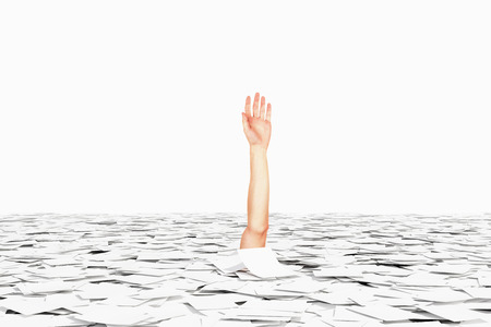 Drowned in paper bureaucracy hand concept Stockfoto