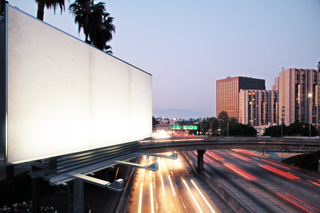 Blank white billboard on the background of the highway at evening, mock up
