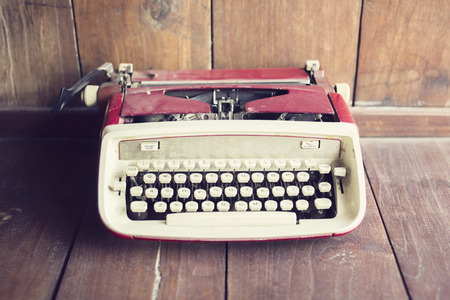 publicist: Old style typewriter on a wooden floor Stock Photo
