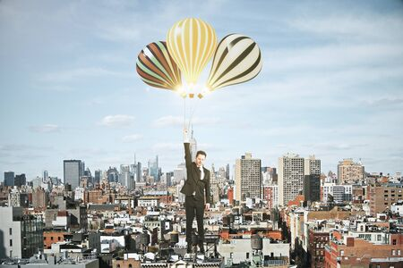 megapolis: Businessman with baloons above megapolis city concept Stock Photo