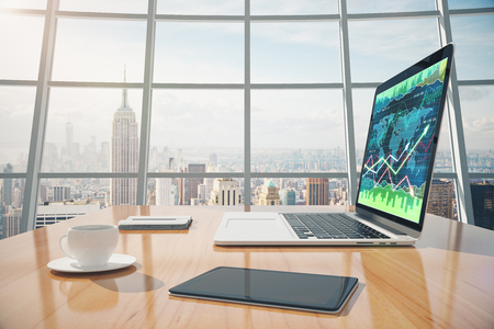 trade: Sunny office with megapolis city view, digital tablet and laptop screen with business chart on the wooden table