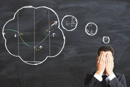 equation: Businessman tries to solve the equation concept Stock Photo